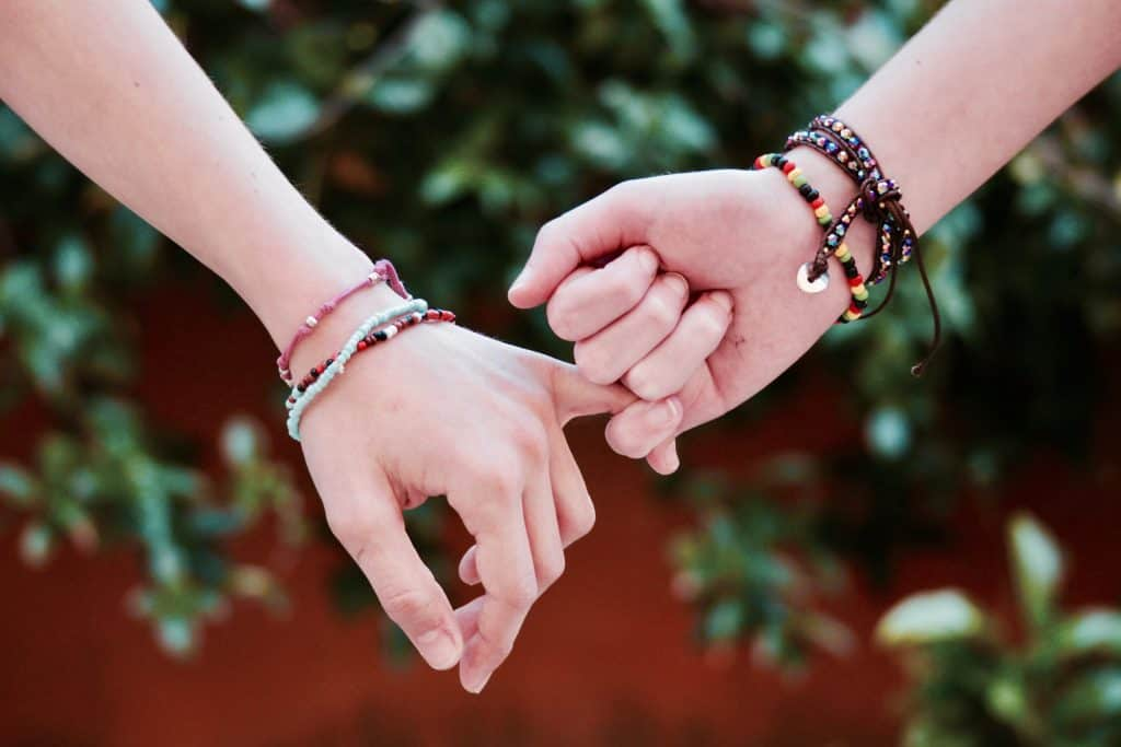 holding hands - words of encouragement to a friend